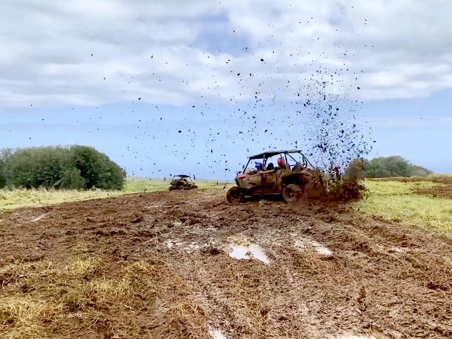 ATVs splashing mud with Kapohokine Adventures in Hilo, Hawaii