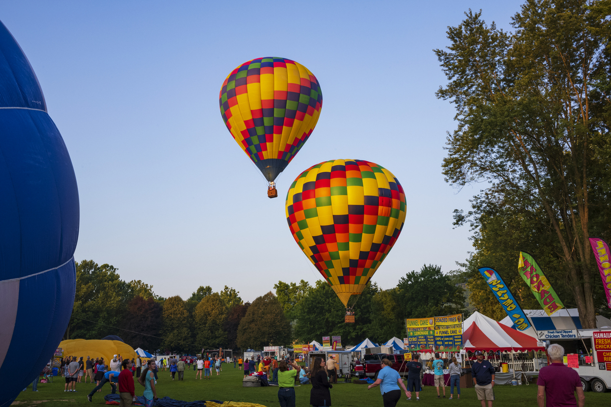Festival goers watch hot air balloons take to flight early Saturday morning, August 3, 2019 on the second day of the 35th annual Spiedie Fest and Balloon Rally Expo, Inc. in Binghamton, New York, USA.