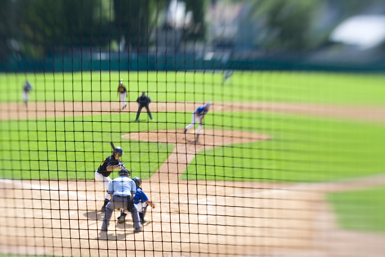 Teams compete in an afternoon baseball game.