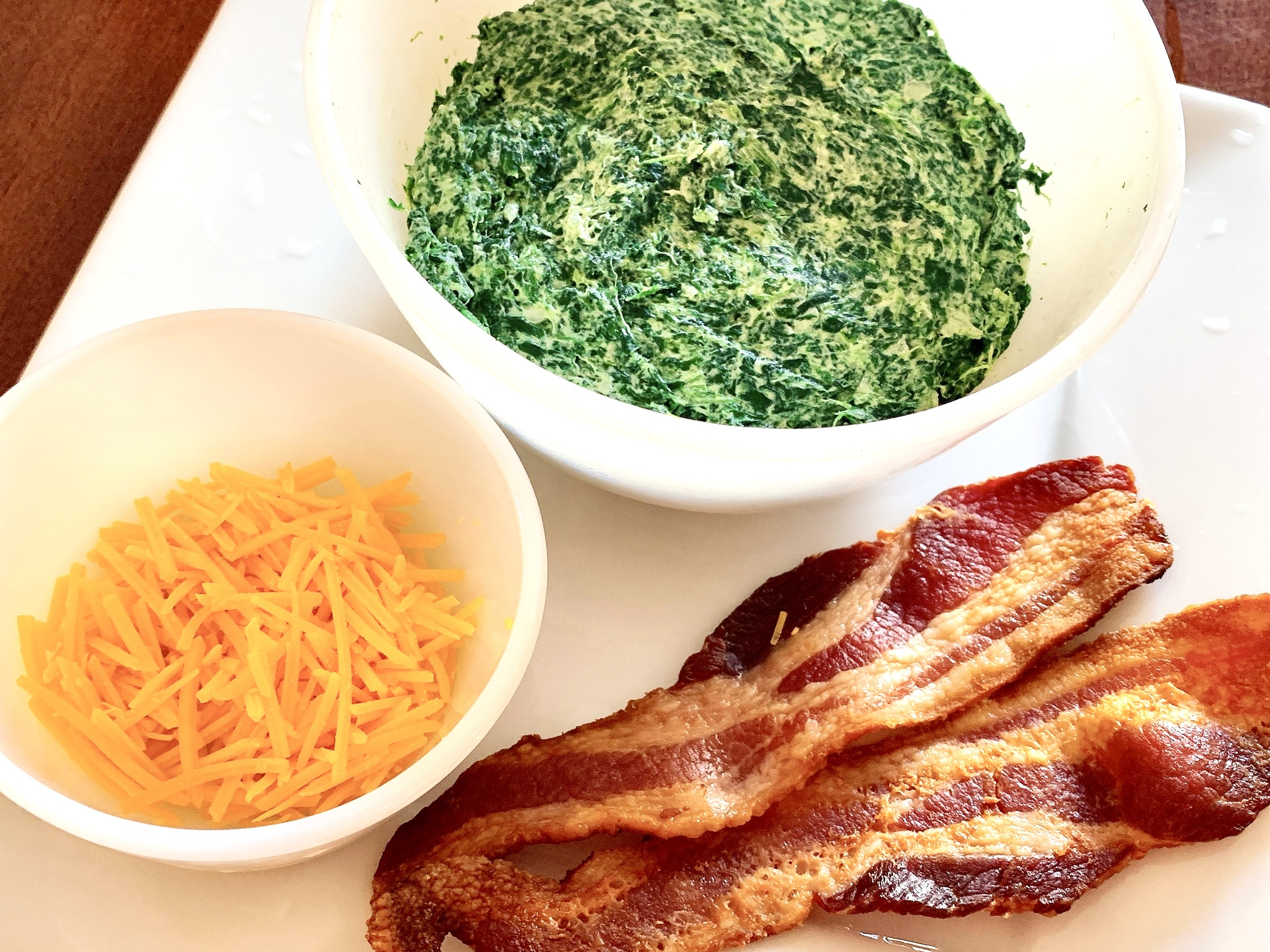 Creamed spinach with cheddar cheese and bacon