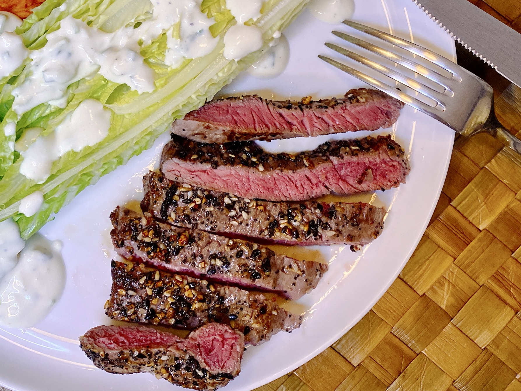 cooked and sliced Panorama Organic Grass-Fed Top Sirloin Steak