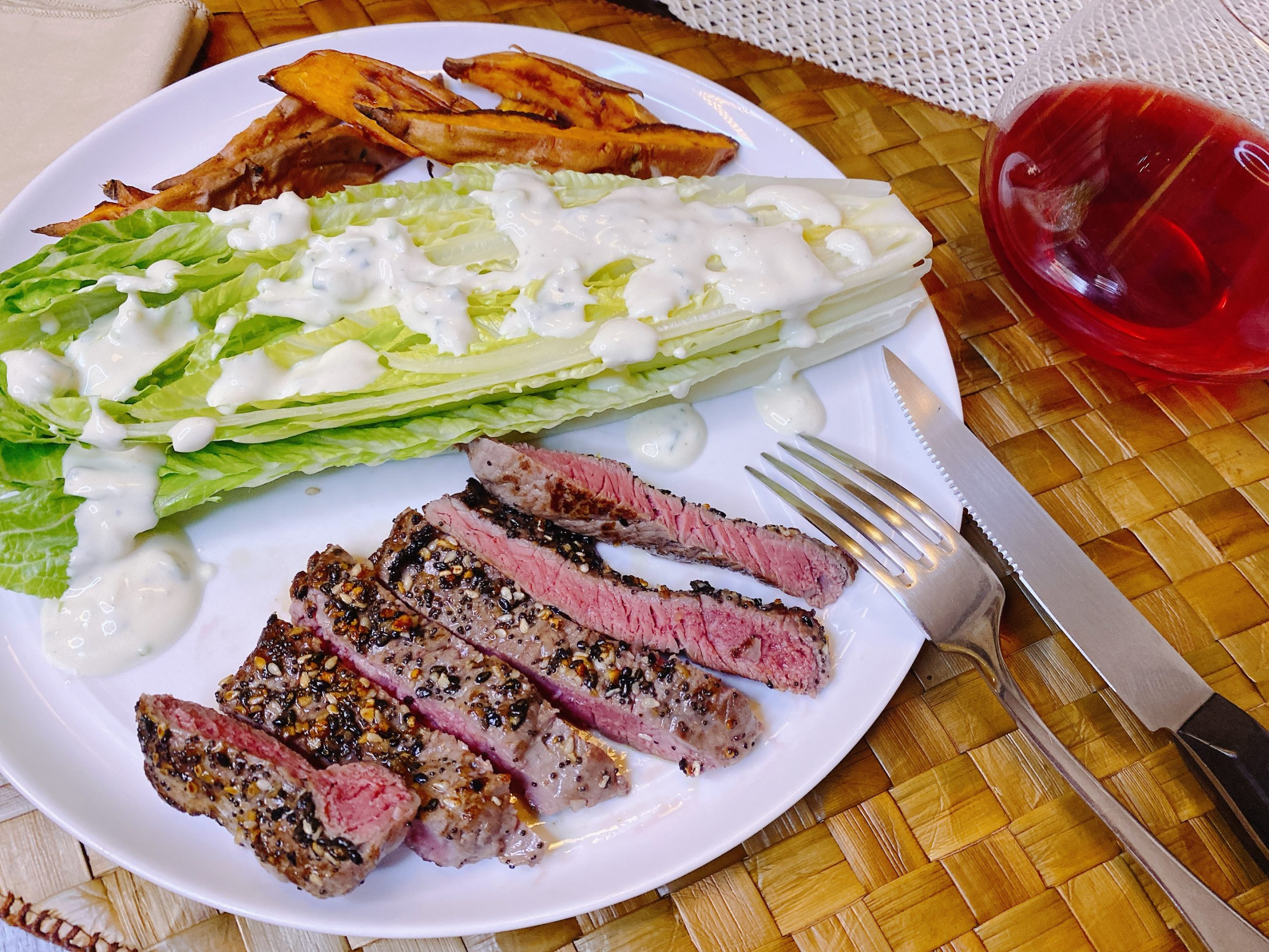 Sirloin Steak from Perdue Farms, sliced on plate with lettuce wedge and potatoes